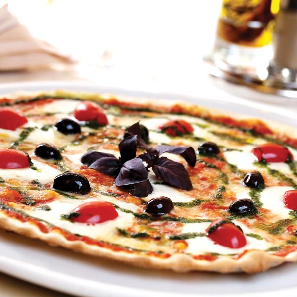 Pesto drizzle on pizza